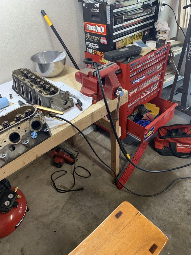 Click image for larger version  Name:Heads on table, exhaust stud removal.jpg Views:71 Size:231.2 KB ID:4104131