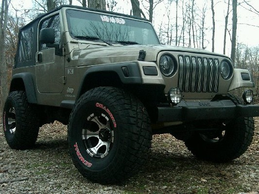 Click image for larger version  Name:khaki TJ with DC-2's.jpg Views:331 Size:79.6 KB ID:174188