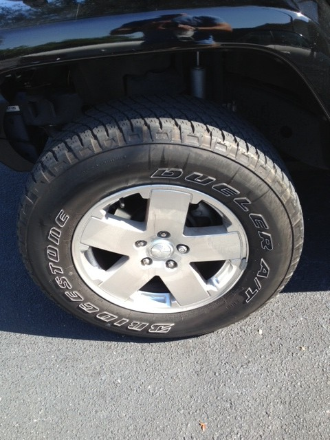 Click image for larger version  Name:Left Front Tire & Sahara Wheel.JPG Views:70 Size:92.8 KB ID:250199